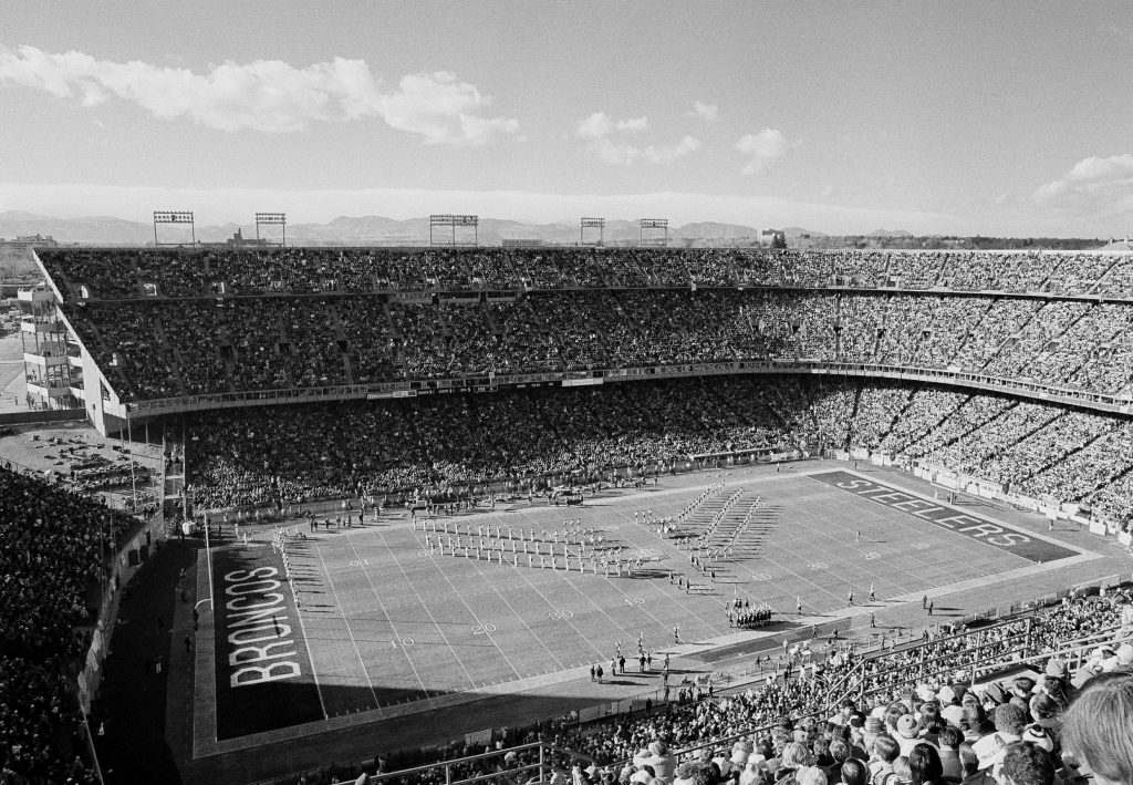 Denver's Mile High Stadium, with the Colorado Rocky Mountains in background, Dec. 24, 1977 is packed with fan's prior to the AFC playoff game between the host Denver Broncos and the Pittsburgh Steelers. (AP Photo)