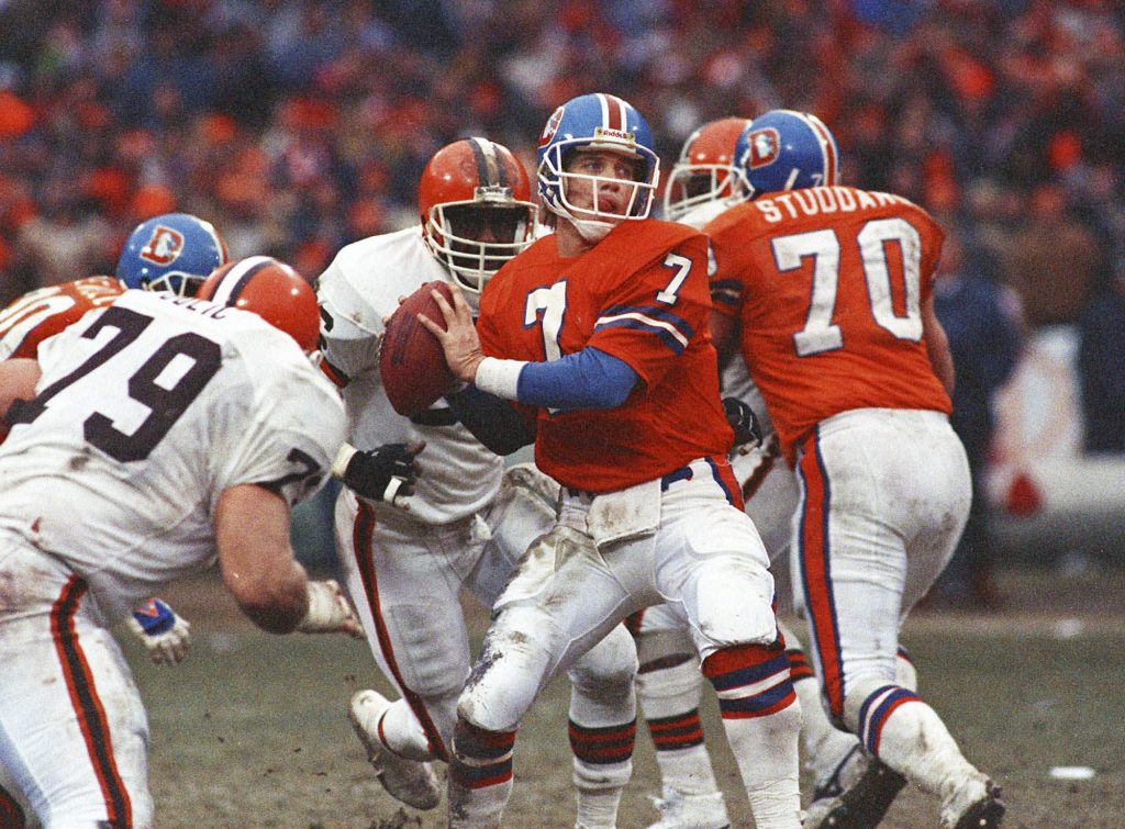 Denver Broncos quarterback John Elway prepares to send the ball down field en route to a 23-20 overtime victory in the AFC Championship game against the Cleveland Browns, in Cleveland. (AP Photo/File)