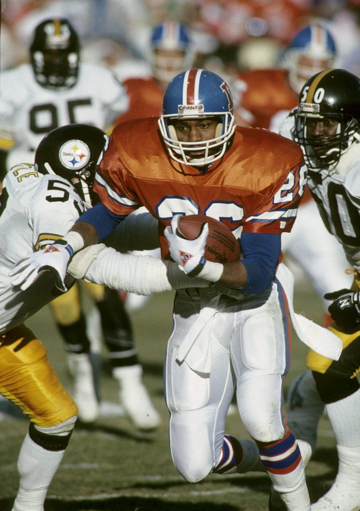 Denver Broncos running back Bobby Humphrey (26) carries the ball during the AFC Divisional Playoff, a 24-23 victory over the Pittsburgh Steelers on January 7, 1990, at Mile High Stadium in Denver, Colorado.  1989 AFC Divisional Playoff Game - Pittsburgh Steelers vs Denver Broncos - January 7, 1990  (AP Photo/NFL Photos)