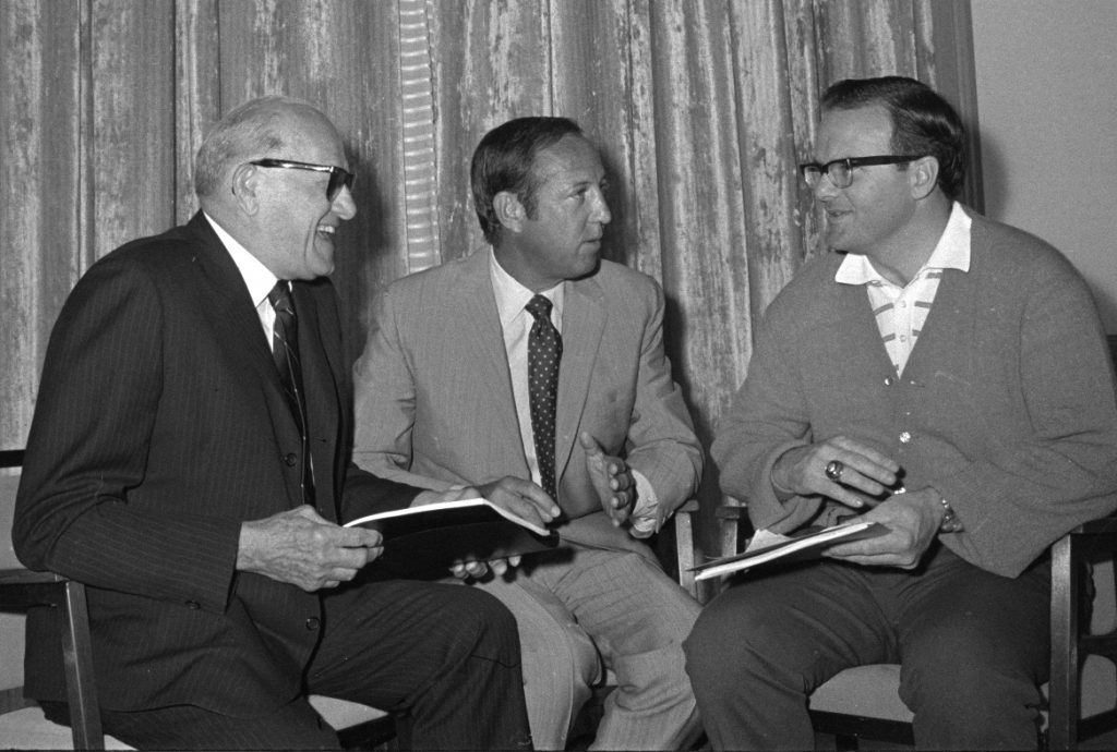 George Halas, left, president of the National Conference of the National Football League, Pete Rozelle, center, commissioner, and Lamar Hunt, president of the American Conference,  chat during the annual meeting of the National Football League in Palm Beach, Fla., in this March 22, 1971 file photo. Lamar Hunt, the Kansas City Chiefs' owner who was a founder of the American Football League and one of the leaders of the AFL-NFL merger, died Wednesday Dec. 13, 2006 in Dallas. He was 74  (AP Photo/File)