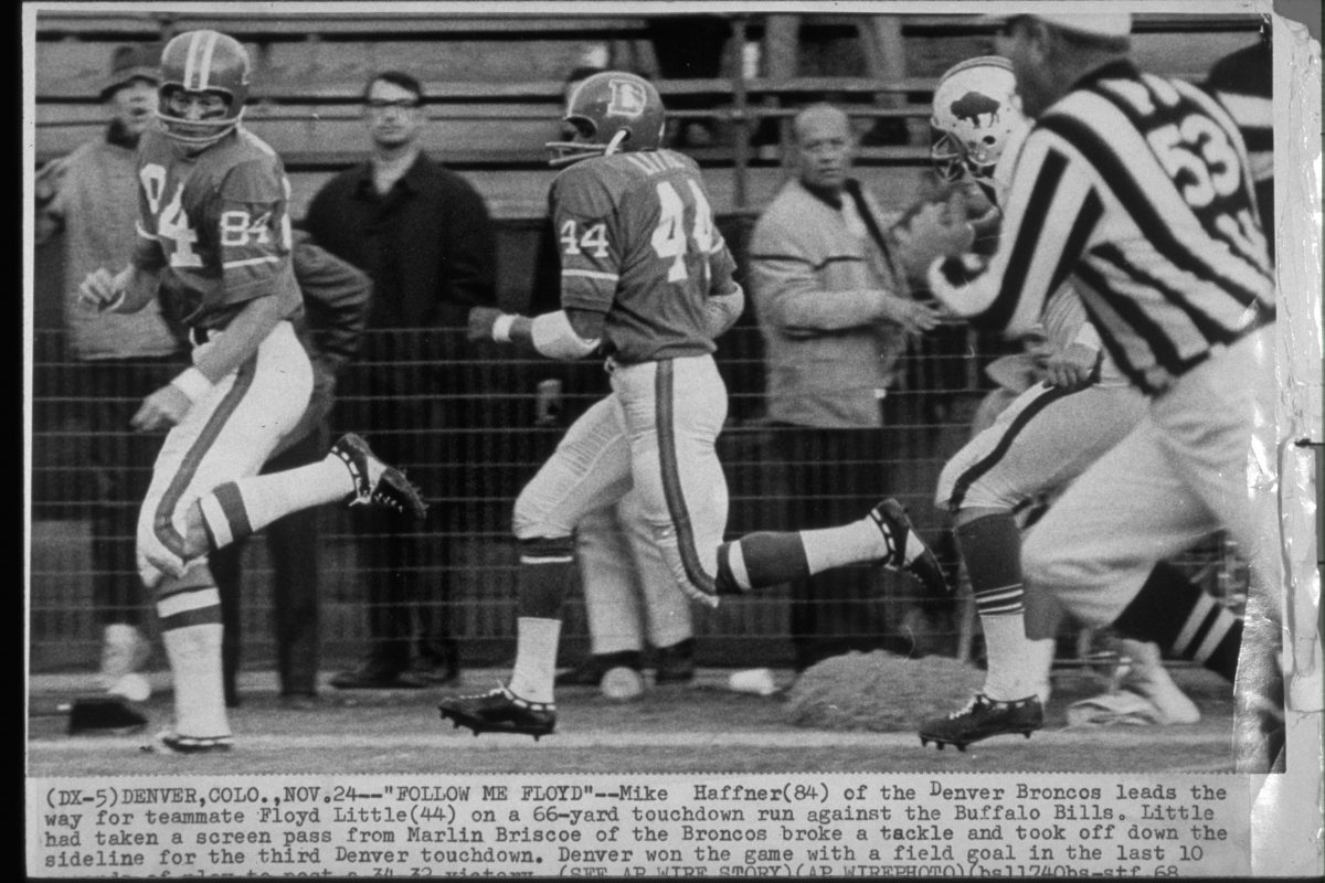 Halfback Floyd Little runs downfield behind lead blocker Mike Haffner on a 66-yard touchdown run during a November 24, 1968 win (34-32) over the Buffalo Bills at Bears Stadium.