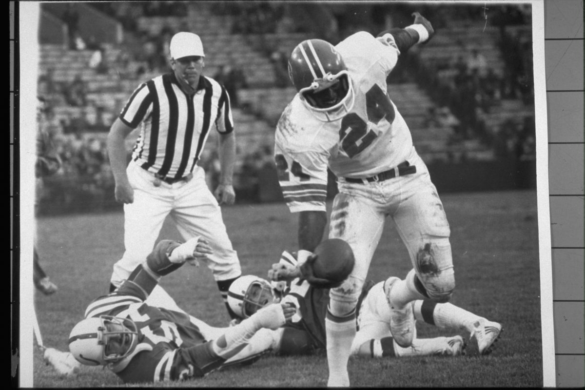 Running back Otis Armstrong grabs the pass but loses 4 yards during a November 10, 1974 win (17-6) against the Colts in Baltimore.
