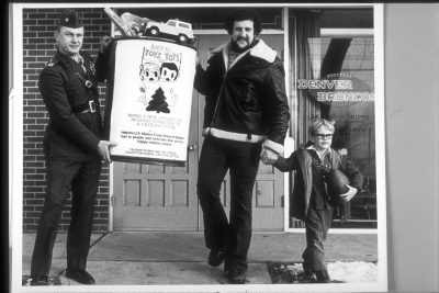 Lyle Alzado helps with the 1975 Toys for Tots campaign.