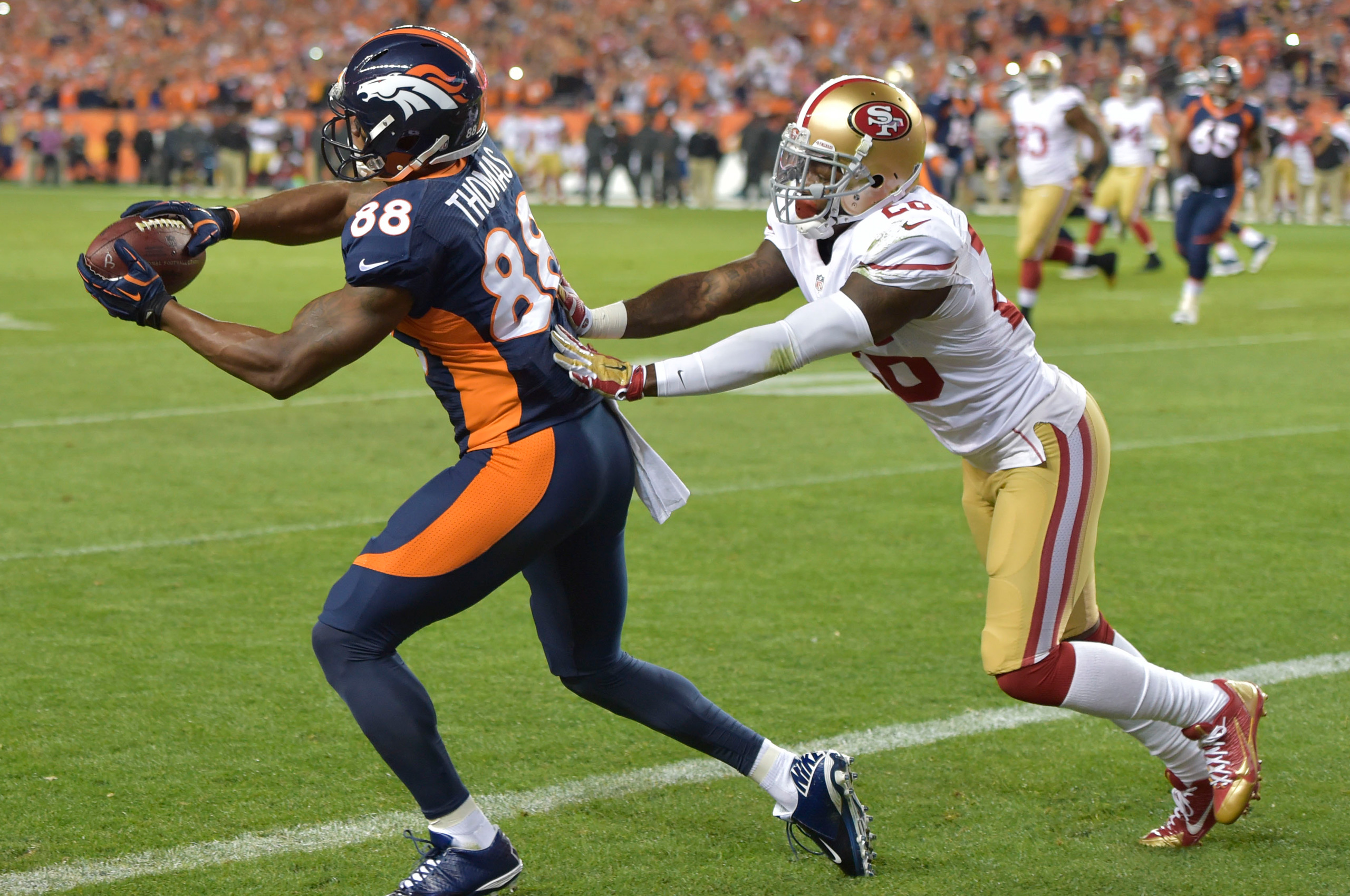 Demaryius Thomas catches quarterback Peyton Manning's 8-yard pass for Manning's 509th career touchdown passes during second-quarter action against the San Francisco 49ers at Sports Authority Field in Denver, Co. October 19, 2014. (Eric Lars Bakke)
