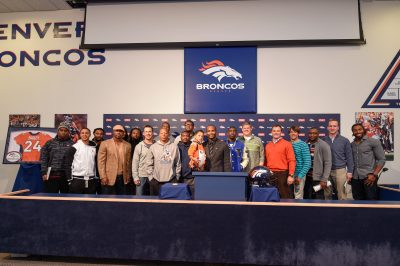 Broncos past and present joined Champ Bailey as he announced his retirement on Nov. 18, 2014. (Eric Lars Bakke)