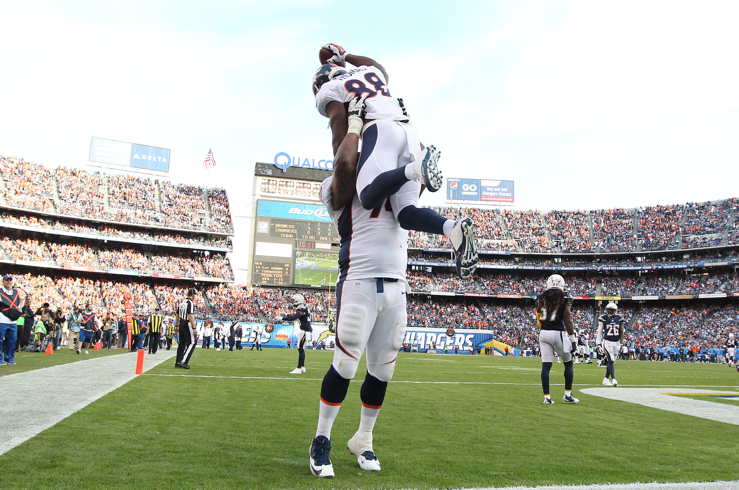 Orlando Franklin lifts wide receiver Demaryius Thomas in the air after scoring a 28-yard touchdown during third quarter action against the San Diego Chargers during the game at Qualcomm Stadium in San Diego, CA, December 14, 2014. (Gabriel Christus)