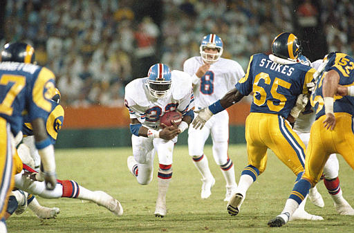 Denver Broncos' Tony Dorsett (33) is seen in action, 1988