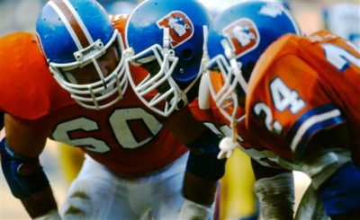 Denver Broncos guard Paul Howard (60) and tackle Ken Lanier (76) listen in the huddle during an NFL game against the Los Angeles Rams in Anaheim, Dec. 12, 1982