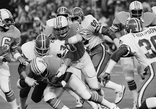 Broncos John Grant tackles Houston Oilers Earl Campbell in 1979 playoff game