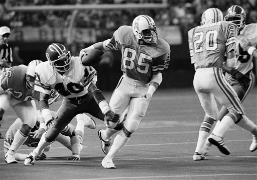 Denver Broncos' Charlie West (40) with a leg and hand trips up Houston Oilers' Richard Ellender (85)