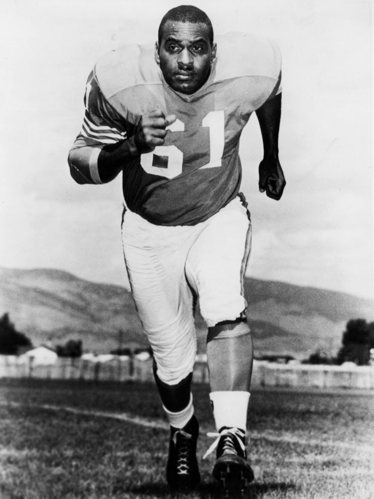 Denver Broncos defensive end Chuck Gavin (61) circa 1962.