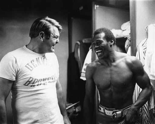 Running back Floyd Little shares a laugh in the locker room before an NFL game against the Oakland Raiders