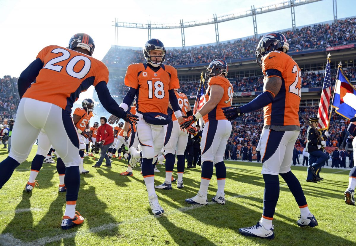 Peyton Manning and teammates