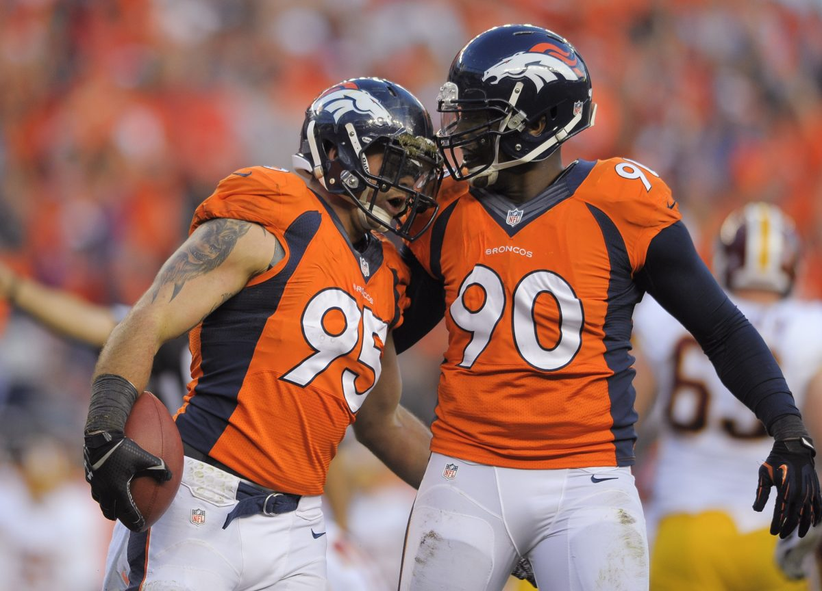 Defensive end Derek Wolfe 95 and defensive end Shaun Phillips