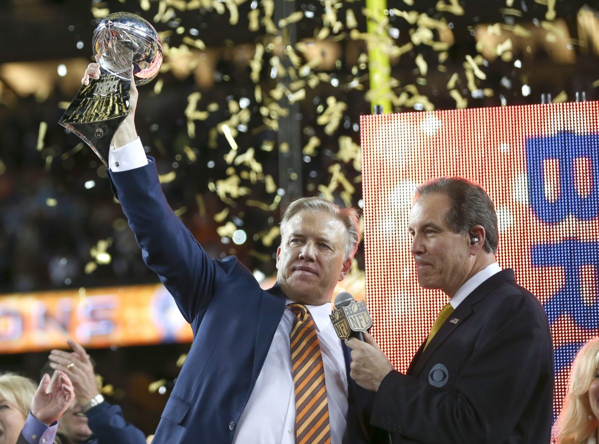 General Manager and Executive Vice President of Football Operations John Elway holds the Vince Lombardi