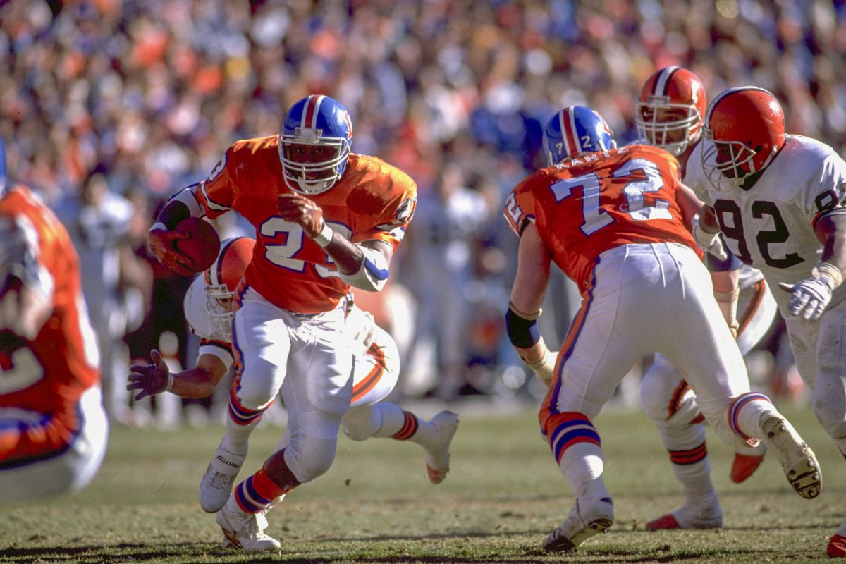 Running back Sammy Winder runs through the hole during the January 14, 1990 AFC Championship win (37-21) against the Cleveland Browns.