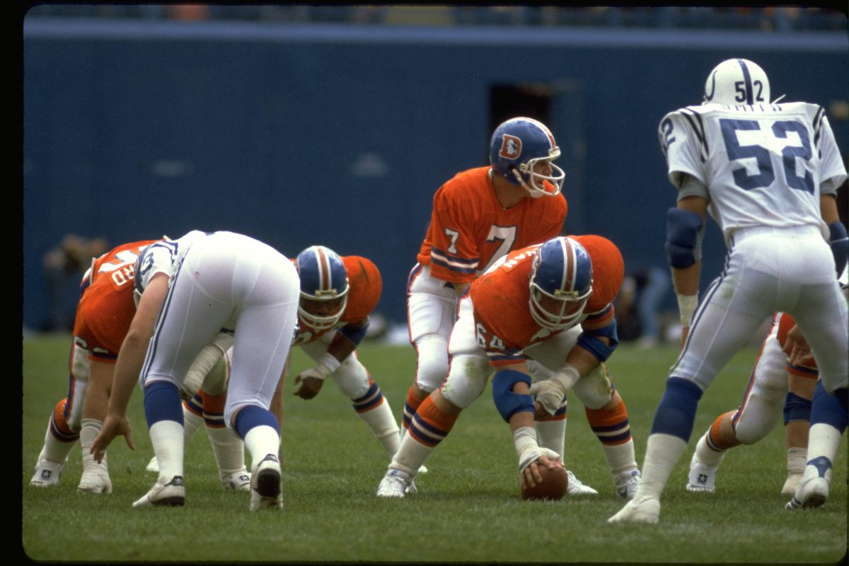 Quarterback Craig Morton prepares to take a snap from center Billy Bryan during a September 20, 1981 win (28-10) to the Baltimore Colts.