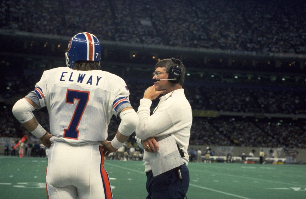 Coach Dan Reeves talks with quarterback John Elway during a November 20, 1988 loss (0-42) to the Saints in New Orleans.