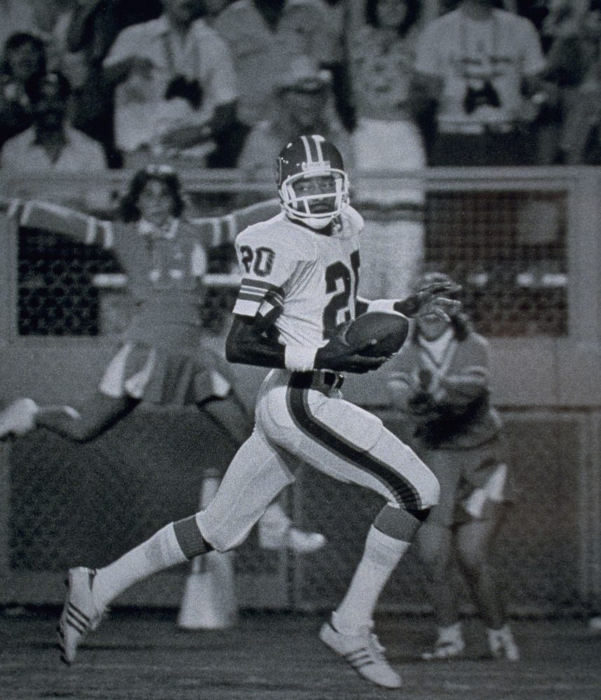 Cornerback Louis Wright runs the ball downfield during a 1980 game.