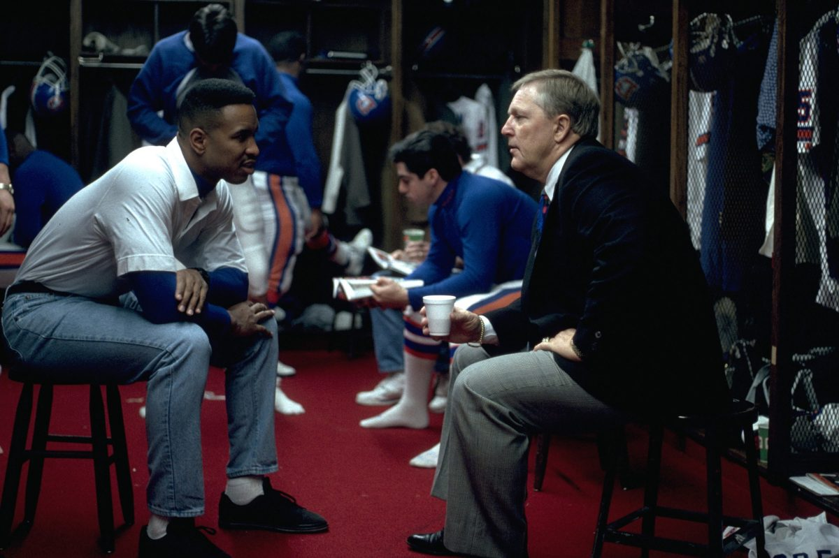 Running back Steve Sewell talks with general manager John Beake in the locker room before a December 27, 1992 loss (20-42) to the Chiefs in Kansas City. It was the final game of Sewell's career.