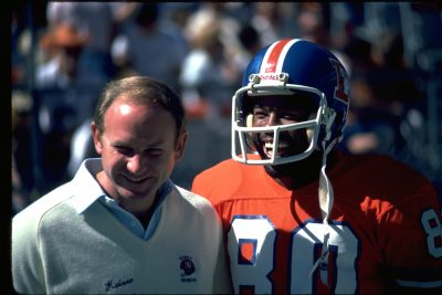 Kaiser talks with wide receiver Rick Upchurch during an October 1981 game.