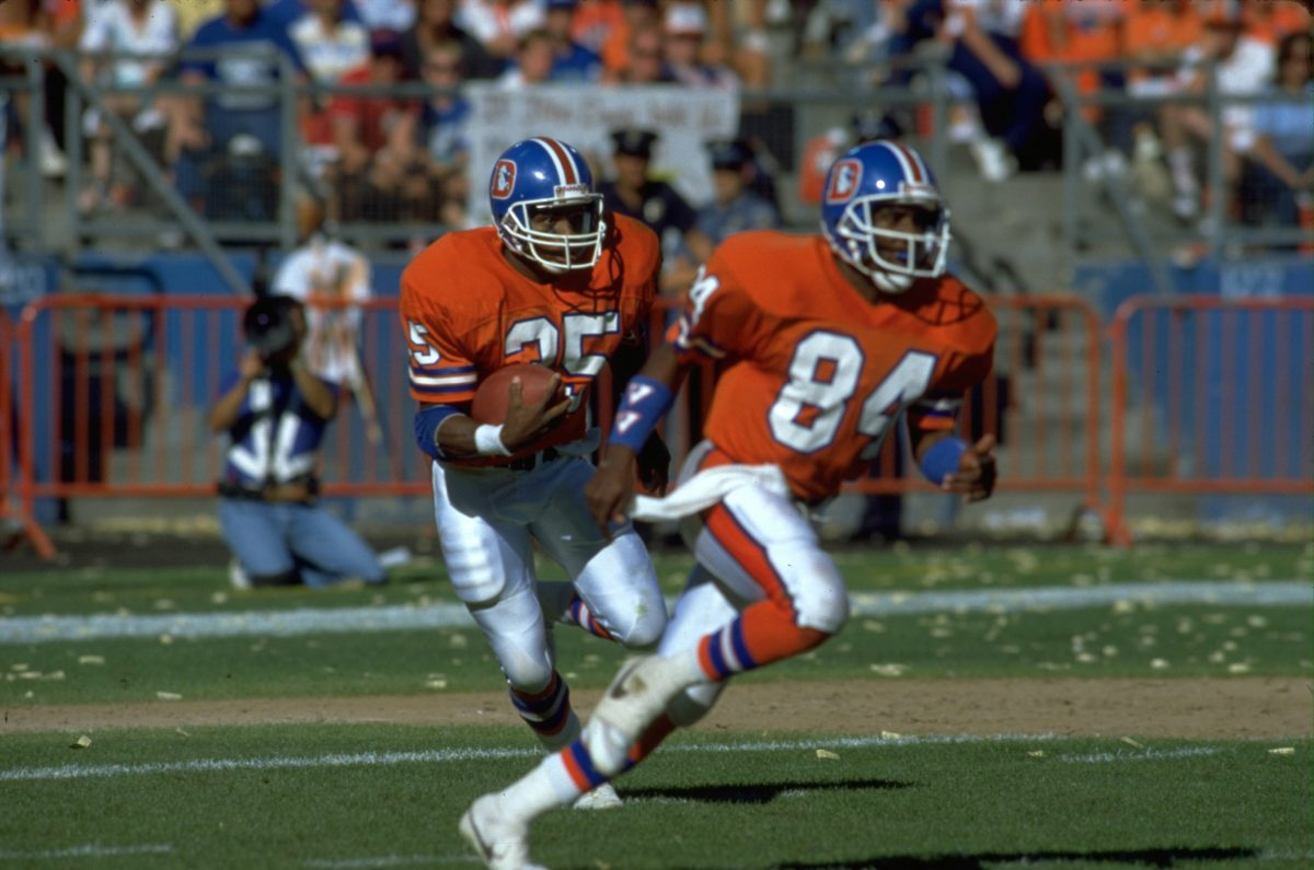 Wide receiver Ricky Nattiel prepares to block for running back Ken Bell during a September 4, 1988 loss (14-21) to the Seattle Seahawks at Mile High Stadium.