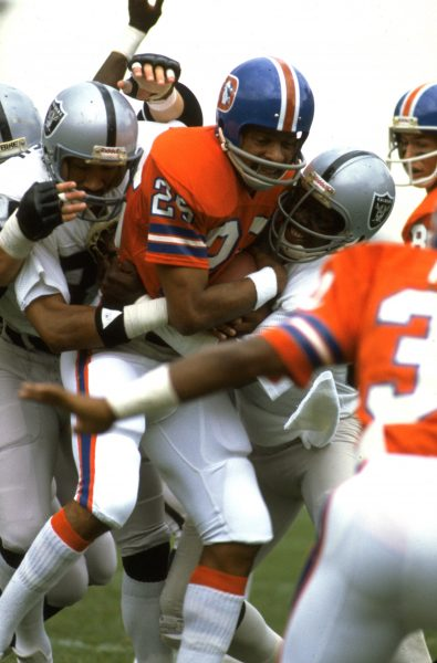 Wide receiver Haven Moses absorbs some punishment in the 1981 season opener against the Oakland Raiders