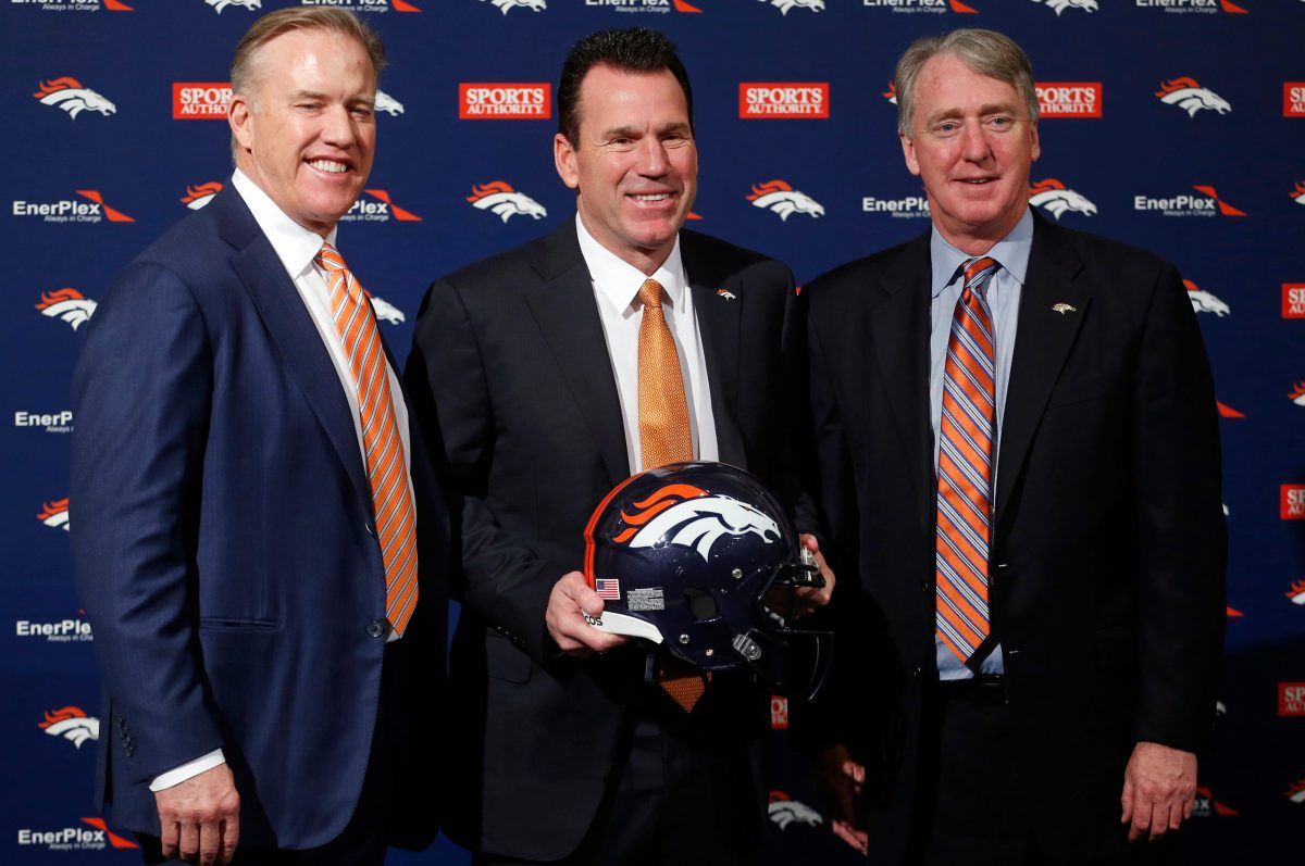 John Elway, left,  poses with new Head Coach Gary Kubiak, center, and Joe Ellis, President, Chairman and CEO of the Broncos, after Kubiak was introduced at an NFL football news conference Tuesday, Jan. 20, 2015, in Englewood, Colo. (AP Photo/Jack Dempsey)