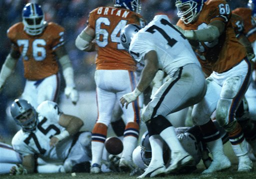 Los Angeles Raiders defensive end Bill Pickel eyes a loose football during an NFL game against the Denver Broncos at Mile High Stadium on December 8, 1985