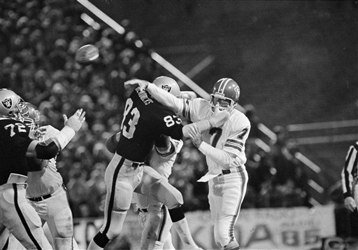 Ted Hendricks of the Oakland Raiders puts the pressure on quarterback Craig Morton of the Denver Broncos