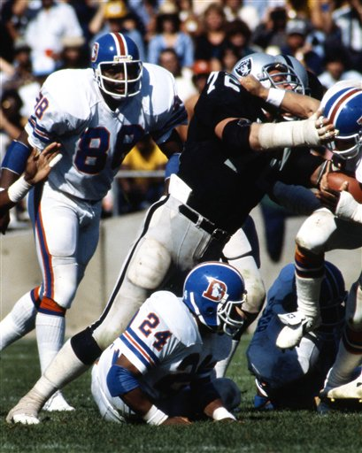 Oakland Raiders defensive end John Matuszak (72) stops a Denver Broncos ball carrier during an NFL game in Oakland, Oct. 4, 1981.