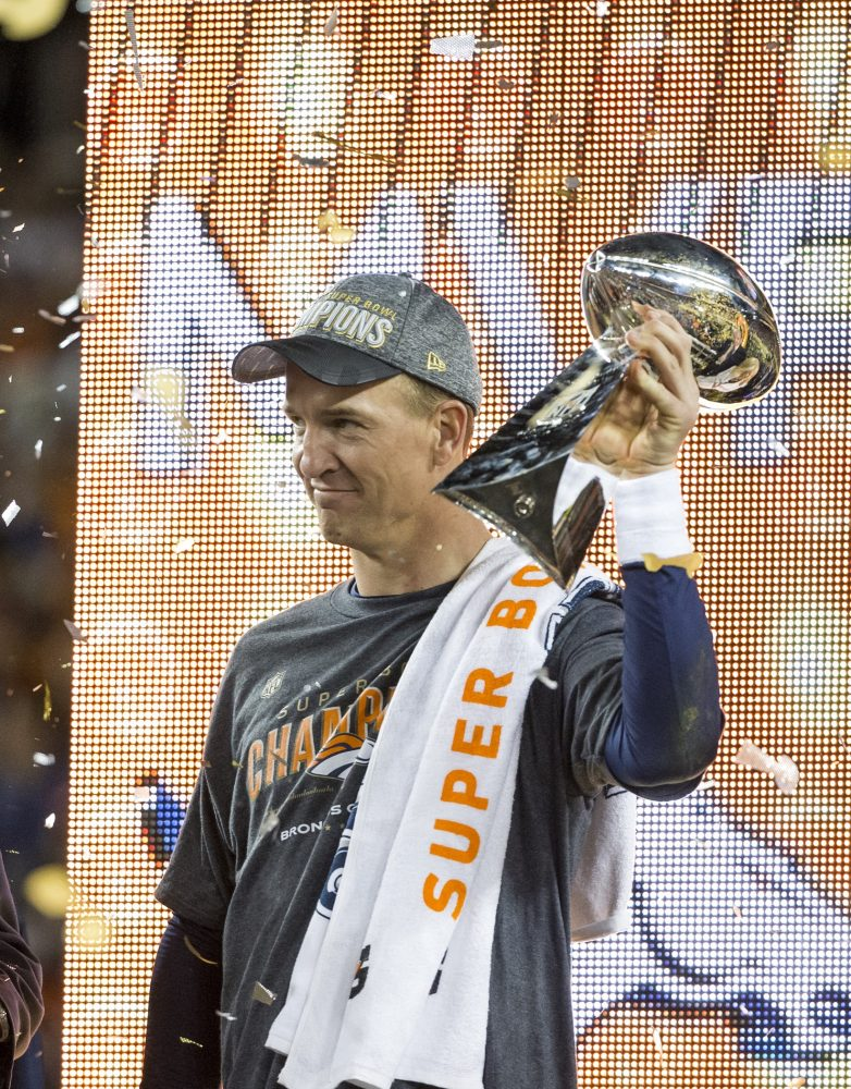 Peyton Manning holds up the Vince Lombardi Trophy
