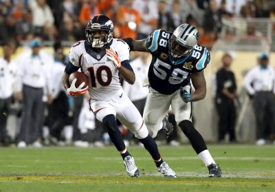 Emmanuel Sanders runs the ball