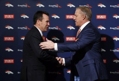 John Elway shakes hands with new coach Gary Kubiak