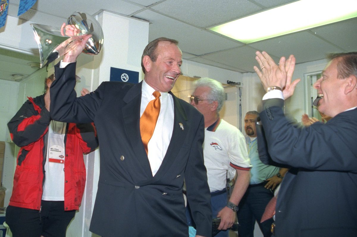Pat Bowlen holds up the trophy
